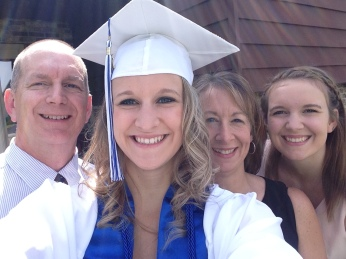 MY NIECE WITH HER PARENTS AND OLDER SISTER, ON HER GRADUATION DAY.