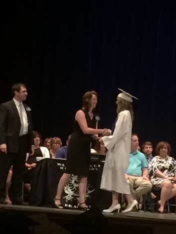 MY NIECE GETTING HER DIPLOMA.