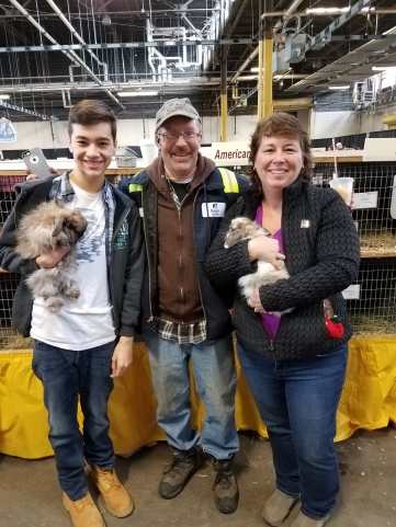 MY NEPHEW DYLAN ON THE LEFT HOLDING A RABBIT, IN THE CENTER IS COUSIN JEFF AND ON THE RIGHT IS MY SISTER HOLDING A RABBIT.
