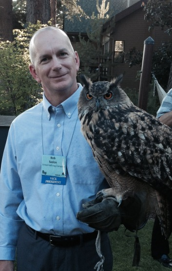 MY BROTHER-IN-LAW BOB HOLDING AN OWL. WHAT A PICTURE OF TWO WISE OLD OWLS.