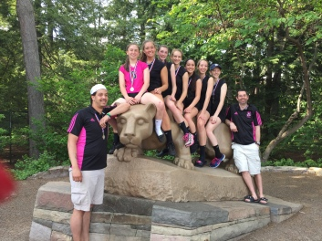 KAITLIN AND HER VOLLEYBALL TEAM ON THE NITTANY LION WITH HER COACHES ON EITHER SIDE.
