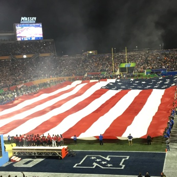 THE AMERICAN FLAG BEING UNFURLED AT THE GAME.