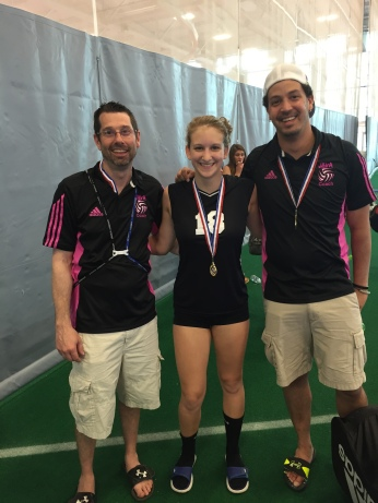 KAITLIN WITH HER VOLLEYBALL COACHES AFTER WINNING A MEDAL.