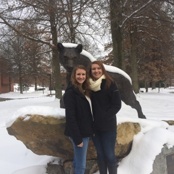 KAITLIN AND ALLISON IN FRONT OF THE NITTANY LION IN THE WINTER..