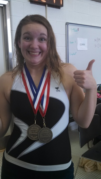 ALLISON SHOWING OFF HER SWIMMING MEDALS.