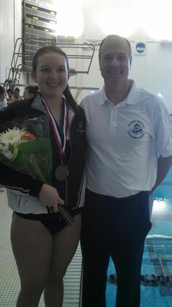 ALLISON WITH HER COACH ON SENIOR NIGHT AFTER WINNING A MEDAL.