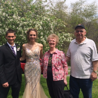 FROM LEFT TO RIGHT IS NICK, EMILY WITH HER GRANDMOTHER AND GRANDFATHER ON PROM NIGHT.