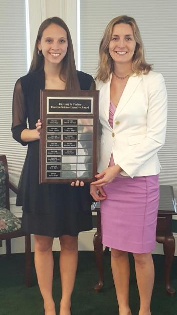 EMILY GETTING AN AWARD FROM HER PROFESSOR AT SLIPPERY ROCK UNIVERSITY.